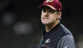 FILE - In this Sunday, Nov. 19, 2017, file photo, Washington Redskins head coach Jay Gruden watches before an NFL football game against the New Orleans Saints in New Orleans. With their losing records and their shaky defenses and their injury-depleted rosters, the Washington Redskins and New York Giants are not exactly ready for prime time, let alone for a national audience tuning in on Thanksgiving night. (AP Photo/Rusty Costanza, File)
