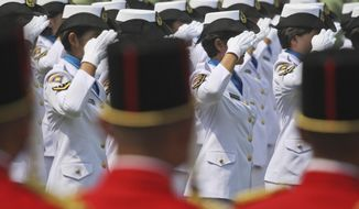 In this Aug. 17, 2012 photo, female members of Indonesian Navy salute during a ceremony commemorating the Independence Day at Merdeka Palace in Jakarta, Indonesia. Indonesia's military and police continue to perform abusive virginity tests on female recruits three years after the World Health Organization declared they had no scientific validity, an international human rights group said Wednesday, Nov. 22, 2017. (AP Photo/Dita Alangkara)