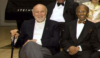 In this Jan. 11, 2011, file photo, NEA Jazz Masters George Avakian, left, and Jimmy Heath pose for a photo at the National Endowment for the Arts Jazz Master Awards Ceremony and Concert held in New York. Avakian, a Russian-born jazz scholar and architect of the American music industry who produced essential recordings by Louis Armstrong, Miles Davis and other stars has died at age 98. Avakian's daughter, Anahid Avakian Gregg, confirmed that her father died Wednesday, Nov. 22, 2017. (AP Photo/Charles Sykes, File)