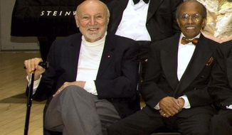 FILE - In this Jan. 11, 2011, file photo, NEA Jazz Masters George Avakian, left, and Jimmy Heath pose for a photo at the National Endowment for the Arts Jazz Master Awards Ceremony and Concert held in New York. Avakian, a Russian-born jazz scholar and architect of the American music industry who produced essential recordings by Louis Armstrong, Miles Davis and other stars has died at age 98. Avakian's daughter, Anahid Avakian Gregg, confirmed that her father died Wednesday, Nov. 22, 2017. (AP Photo/Charles Sykes, File)
