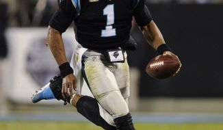 In this Nov. 13, 2017, photo, Carolina Panthers quarterback Cam Newton (1) runs against the Miami Dolphins in the second half of an NFL football game in Charlotte, N.C. Newton said his arrest in 2008 when he was at the University of Florida helped change his life. (AP Photo/Mike McCarn)