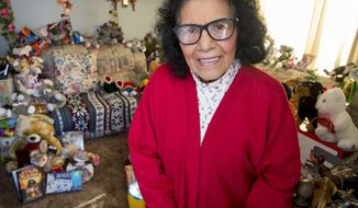 ADVANCE FOR WEEKEND EDITIONS, NOV. 18-19 - In this recent photo, Sally Montoya, 87, has been a volunteer working to assist those in need since 1949 as she prepares for her 68th busy holiday season as a volunteer helping those in need in Powell, Wyo. (Mark Davis/The Powell Tribune via AP)