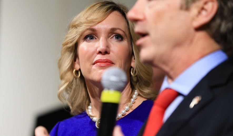 In this Feb. 1, 2016, file photo, Kelley Paul, wife of Republican Sen. Rand Paul, R-Ky, watches him speak to supporters during a caucus night rally at the Scottish Rite Consistory in Des Moines, Iowa. (AP Photo/Nati Harnik, File)