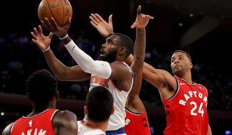 New York Knicks forward Tim Hardaway Jr. (3) drives past Toronto Raptors forward Norman Powell (24) during the fourth quarter of an NBA basketball game, Wednesday, Nov. 22, 2017, in New York. The Knicks won 108-100. (AP Photo/Julie Jacobson)