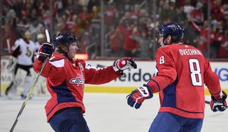Washington Capitals left wing Alex Ovechkin (8), of Russia, celebrates his goal with center Nicklas Backstrom, of Sweden, during the first period of an NHL hockey game against the Ottawa Senators, Wednesday, Nov. 22, 2017, in Washington. (AP Photo/Nick Wass)