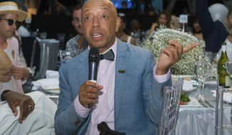 FILE - In this July 16, 2016 file photo, Def Jam Records mogul Russell Simmons speaks at the 2016 Art For Life Benefit in Water Mill, N.Y. Simmons, who has been accused by a model of sexual misconduct in 1991, has penned an essay in response, reiterating that the relationship was consensual and not violent. (Photo by Scott Roth/Invision/AP, File)