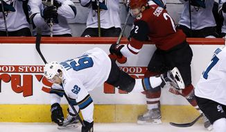 Arizona Coyotes defenseman Luke Schenn (2) checks San Jose Sharks right wing Kevin Labanc (62) into the boards during the second period of an NHL hockey game Wednesday, Nov. 22, 2017, in Glendale, Ariz. (AP Photo/Ross D. Franklin)