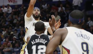 New Orleans Pelicans forward Anthony Davis (23) shoots over San Antonio Spurs forward LaMarcus Aldridge (12) in the first half of an NBA basketball game in New Orleans, Wednesday, Nov. 22, 2017. (AP Photo/Scott Threlkeld)