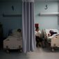 Patients lie in their beds at a hospital in Catano, Puerto Rico. The FDA says drug shortages are possible because of long-term power outages in the territory. (Associated Press)