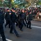 New York Police Department officers are before the start of the Macy's Thanksgiving Day Parade in New York, on Thursday. Some Dreamers tried to disrupt the parade. (Associated Press)