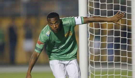 FILE - In this file photo dated Thursday, Dec. 22, 2016, Robinho celebrates after scoring in a friendly soccer match between Friends of Neymar and Friends of Robinho, in Sao Paulo, Brazil. Former AC Milan and Real Madrid striker Robinho was sentenced to nine years in jail by a court in Milan, Italy, on charges of sexual assault following an incident in 2013, Italian news agency ANSA reported Thursday Nov. 23, 2017, who also report a statement from Robinho's lawyer, that Robinho denies the charges and will appeal. (AP Photo/Nelson Antoine, FILE) **FILE**