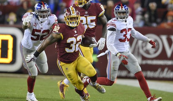 Washington Redskins running back Samaje Perine (32) carries the ball during the second half of an NFL football game against the New York Giants in Landover, Md., Thursday, Nov. 23, 2017. (AP Photo/Nick Wass)
