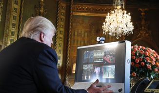 President Donald Trump speaks with members of the armed forces via video conference at his private club, Mar-a-Lago, on Thanksgiving, Thursday, Nov. 23, 2017, in Palm Beach, Fla. (AP Photo/Alex Brandon)