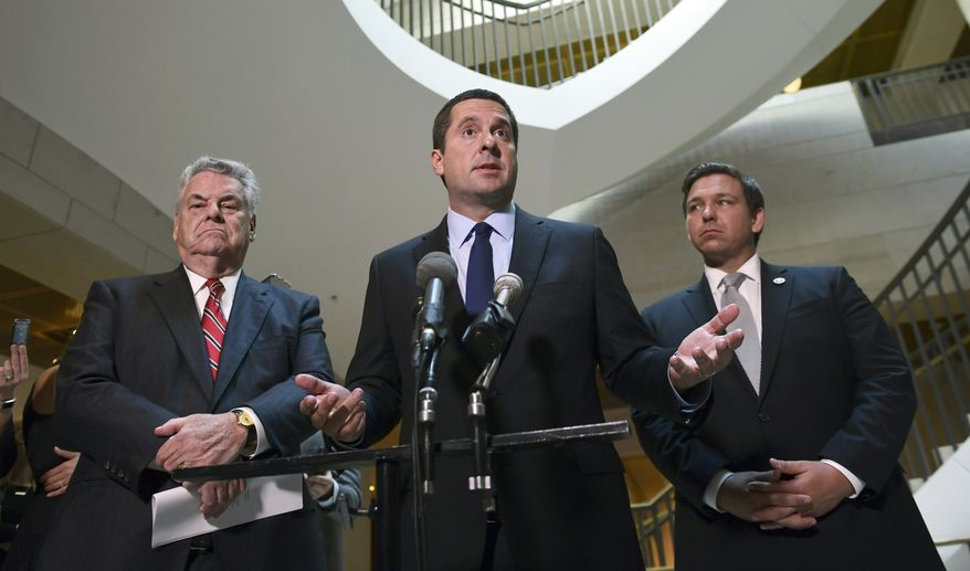 House Intelligence Committee Chairman Rep. Devin Nunes, R-Calif., center, standing with Rep. Peter King, R-N.Y., left, and Rep. Ron DeSantis, R-Fla., right, speaks on Capitol Hill in Washington. Mr. Nunes wants to know if the FBI knew the dossier was funded by the Democratic Party in the summer and fall of 2016, when the bureau opened a Trump-Russia counterintelligence probe. (AP Photo/Susan Walsh, File)