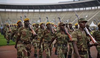 Zimbabwean military parade during a dress rehearsal ahead of Friday's presidential inauguration of Emmerson Mnangagwa, at the National Sports Stadium in Harare, Zimbabwe, Thursday, Nov. 23, 2017.  Zimbabwe on Thursday was making preparations to swear in a new leader after 37-years of rule by Robert Mugabe. (AP Photo/Ben Curtis)