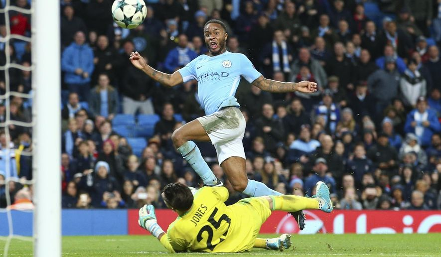 Manchester City's Raheem Sterling scores past Feyenoord goalkeeper Bradley Jones during the Champions League group F soccer match between Manchester City and Feyenoord, at the Etihad Stadium in Manchester, England, Tuesday, Nov. 21, 2017. (AP Photo/Dave Thompson)