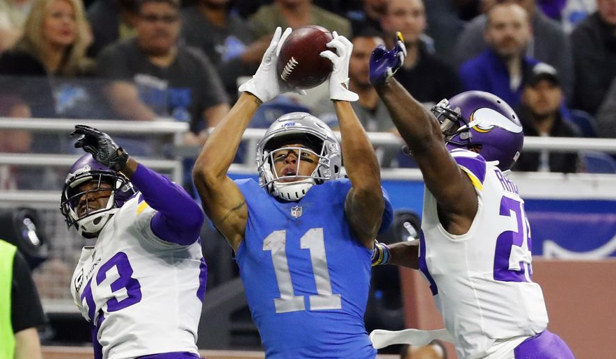 Detroit Lions wide receiver Marvin Jones (11), guarded by Minnesota Vikings cornerbacks Terence Newman (23) and Xavier Rhodes (29), catches a 43-yard pass for a touchdown during the second half of an NFL football game, Thursday, Nov. 23, 2017, in Detroit. (AP Photo/Rick Osentoski)