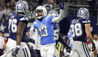 Los Angeles Chargers wide receiver Keenan Allen (13) celebrates catching a pass for a first down as Dallas Cowboys' Richard Ash (76) and Jeff Heath (38) watch late in the second half of an NFL football game, Thursday, Nov. 23, 2017, in Arlington, Texas. (AP Photo/Michael Ainsworth)