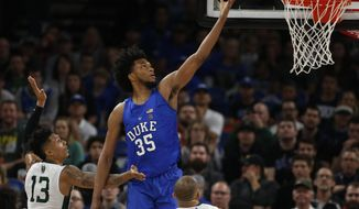 Duke's Marvin Bagley, III (35) gets past Portland State's Jamie Orme (13) for two points during the first half of an NCAA basketball game during the Phil Knight Invitation tournament in Portland, Ore., Thursday, Nov. 23, 2017. (AP Photo/Timothy J. Gonzalez)
