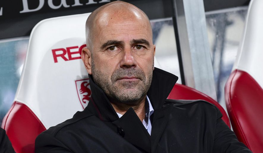 FILE - In this Nov. 17, 2017 file photo Dortmund's coach Peter Bosz sitting on the bench before the German Bundesliga soccer match between VfB Stuttgart and Borussia Dortmund in the Mercedes Benz Arena in Stuttgart, Germany. Dortmund will face  Schalke 04 in a derby, Saturday Nov. 25.  (Sebastian Gollnow/dpa via AP)