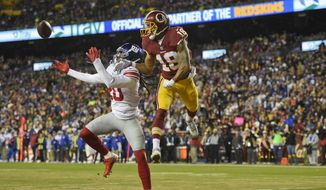 New York Giants cornerback Janoris Jenkins (20) reaches for a pass intended Washington Redskins wide receiver Josh Doctson (18) during the first half of an NFL football game in Landover, Md., Thursday, Nov. 23, 2017. (AP Photo/Nick Wass) **FILE**