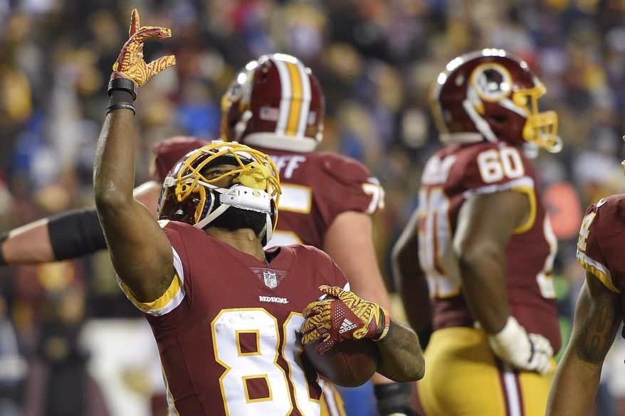 Washington Redskins wide receiver Jamison Crowder (80) celebrates his touchdown catch during the second half of an NFL football game against the New York Giants in Landover, Md., Thursday, Nov. 23, 2017. (AP Photo/Nick Wass)