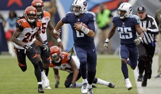 In this Sunday, Nov. 12, 2017 file photo, Tennessee Titans quarterback Marcus Mariota (8) scrambles against the Cincinnati Bengals in the first half of an NFL football game in Nashville, Tenn. Tennessee is coming off its worst rushing performance this season and has slipped out of the NFL's top 10. The Titans believe they're not far away from the unit that led the AFC in rushing last season, and a trip to Indianapolis could help them make the needed corrections  (AP Photo/James Kenney, File)