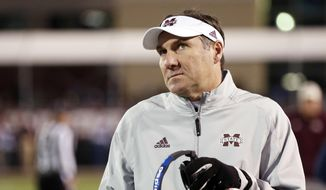 Mississippi State coach Dan Mullen gives the scoreboard in the closing seconds of the team's 31-28 loss to Mississippi in anNCAA college football game in Starkville, Miss., Thursday, Nov. 23, 2017. (AP Photo/Rogelio V. Solis) **FILE**