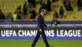 Monaco's head coach Leonardo Jardim walks away after the Champions League Group G soccer match between Monaco and Leipzig at the Louis II stadium in Monaco, Tuesday Nov. 21, 2017. Leipzig won 4-1. (AP Photo/Claude Paris)