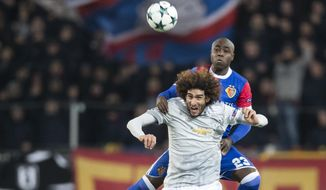 Basel's Eder Balanta up, fights for the ball against Manchester United's Marouane Fellaini, during the Champions League Group A soccer match between Switzerland's FC Basel 1893 and England's Manchester United at the St. Jakob-Park stadium in Basel, Switzerland, Wednesday, Nov. 22, 2017. (Ennio Leanza/Keystone via AP)