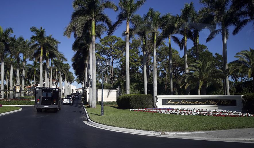 The motorcade of President Donald Trump arrives at at the Trump International Golf Club, Wednesday, Nov. 22, 2017, in West Palm Beach, Fla. (AP Photo/Alex Brandon)
