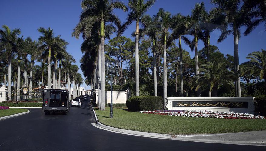The motorcade of President Donald Trump arrives at at the Trump International Golf Club, Wednesday, Nov. 22, 2017, in West Palm Beach, Fla. (AP Photo/Alex Brandon)