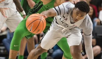 Connecticut guard Alterique Gilbert, right, steals the ball away from Oregon forward Keith Smith, left, during the second half of an NCAA college basketball game at the Phil Knight Invitational tournament in Portland, Ore., Thursday Nov. 23, 2017. (AP Photo/Troy Wayrynen)
