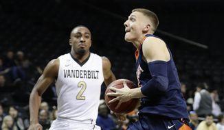 Virginia's Kyle Guy (5) drives past Vanderbilt's Joe Toye (2) during the second half of an NCAA college basketball game in the NIT Season Tip-Off tournament Thursday, Nov. 23, 2017, in New York. Virginia won 68-42. (AP Photo/Frank Franklin II)