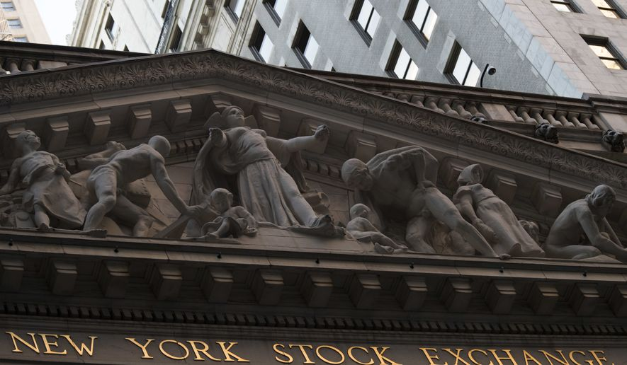 This Tuesday, Oct. 25, 2016, file photo shows the New York Stock Exchange at sunset, in lower Manhattan. On Friday, Nov. 24, 2017, Donald Trump named OMB director Mick Mulvaney as the acting director of the federal government's Wall Street watchdog, the Consumer Financial Protection Bureau. (AP Photo/Mary Altaffer, File) **FILE**