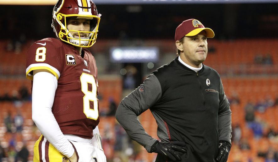Washington Redskins quarterback Kirk Cousins (8) and head coach Jay Gruden stand on the field prior to an NFL football game against the New York Giants, Thursday, Nov. 23, 2017, in Landover, Md. (AP Photo/Mark Tenally)