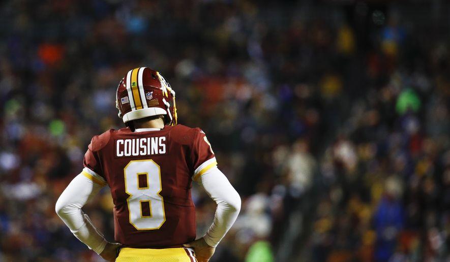 Washington Redskins quarterback Kirk Cousins (8) looks back toward the bench during the first half of an NFL football game against the New York Giants in Landover, Md., Thursday, Nov. 23, 2017. (AP Photo/Patrick Semansky)