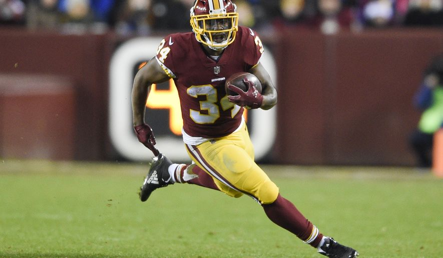 Washington Redskins running back Byron Marshall (34) carries the ball during the second half of an NFL football game against the New York Giants in Landover, Md., Thursday, Nov. 23, 2017. (AP Photo/Nick Wass)