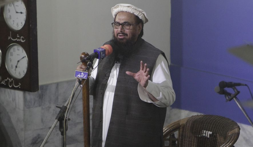 Hafiz Saeed, head of the Pakistani religious party, Jamaat-ud-Dawa, gives Friday sermon at a mosque in Lahore, Pakistan, Friday, Nov. 24, 2017. Pakistani authorities acting on a court order released a U.S.-wanted militant Friday who allegedly founded a banned group linked to the 2008 Mumbai, India, attack that killed 168 people, his spokesman and officials said. (AP Photo/K.M. Chaudary)