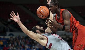 Florida's Deaundrae Ballard, right, is called for an offensive foul after running into Stanford's Josh Sharma in the first half of an NCAA college basketball game during the Phil Knight Invitational tournament in Portland, Ore., Thursday, Nov. 23, 2017. (AP Photo/Timothy J. Gonzalez)