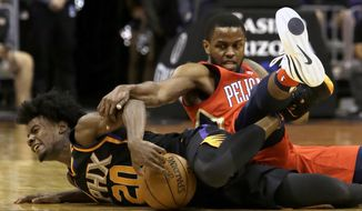 Phoenix Suns forward Josh Jackson (20) and New Orleans Pelicans forward Darius Miller battle for the ball in the first half during an NBA basketball game, Friday, Nov 24, 2017, in Phoenix. (AP Photo/Rick Scuteri)