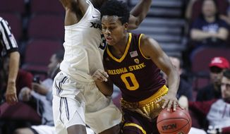 Arizona State's Tra Holder, right, drives into Xavier's Quentin Goodin during the first period of an NCAA college basketball game Friday, Nov. 24, 2017, in Las Vegas. (AP Photo/John Locher)