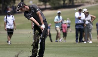 Australia's Lucas Herbert hits a shot on the 18th hole during the second round of the Australian Open Golf tournament in Sydney, Friday, Nov. 24, 2017. (AP Photo/Rick Rycroft)