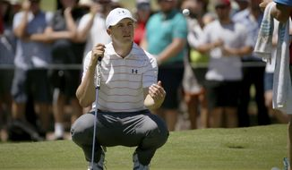 Jordan Spieth of the U.S. tosses his ball to his caddie on the 2nd green during the third round of the Australian Open Golf tournament in Sydney, Saturday, Nov. 25, 2017. (AP Photo/Rick Rycroft)