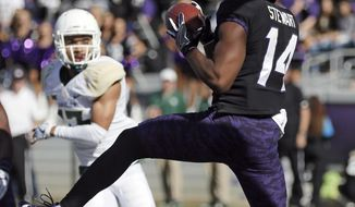 TCU wide receiver Jarrison Stewart (14) catches a pass for a touchdown during the first half of an NCAA college football game against Baylor, Friday, Nov. 24, 2017, in Fort Worth, Texas. (AP Photo/Brandon Wade)