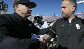 TCU head coach Gary Patterson, left, and Baylor head coach Matt Rhule shake hands after an NCAA college football game, Friday, Nov. 24, 2017, in Fort Worth, Texas. TCU won 45-22. (AP Photo/Brandon Wade)