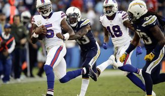 FILE - In this Sunday, Nov. 19, 2017, file photo, Buffalo Bills quarterback Tyrod Taylor runs against the Los Angeles Chargers during the second half of an NFL football game in Carson, Calif. The Bills and Chiefs have been riding a similar rollercoaster this season. They both started hot behind great play at quarterback, and they both have stumbled as their QB play has suffered. Throw in similar injuries and you get two teams trying to right their season when they meet Sunday at Arrowhead Stadium.(AP Photo/Jae C. Hong, File)