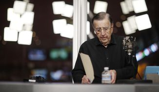 In this Nov. 16, 2017, photo, Brent Musburger looks at notes during a broadcast at the South Point hotel and casino in Las Vegas. During the show, part of the Vegas Stats & Information Network, Musburger and others talk about sports betting. (AP Photo/John Locher)