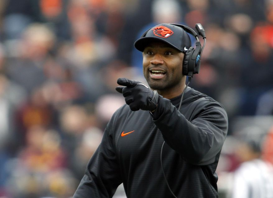 FILE - In this Nov. 18, 2917, file photo, Oregon State head coach Cory Hall gestures during an NCAA college football game, in Corvallis, Ore. Oregon and Oregon State head into the 121st Civil War game in Eugene, Ore., Saturday, Nov. 25, 2017, looking very different than last season. (AP Photo/Timothy J. Gonzalez, File)