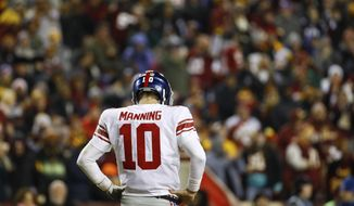 New York Giants quarterback Eli Manning (10) looks down at the turf during the second half of an NFL football game against the Washington Redskins in Landover, Md., Thursday, Nov. 23, 2017. (AP Photo/Patrick Semansky)